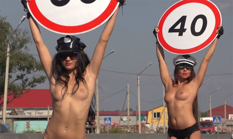russia-topless-women-speed-up-heartbeats-to-slow-down-cars